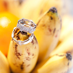 Wedding rings on bananas fruit, wedding in tropics