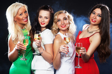 girls clinking flutes with sparkling wine