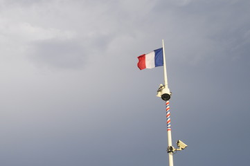 French flag on gray sky