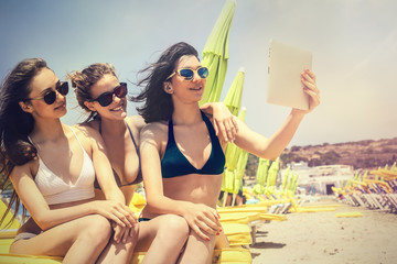 Three girls doing a selfie at the beach