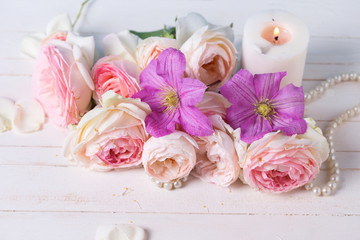 Roses and clematis   flowers and candle