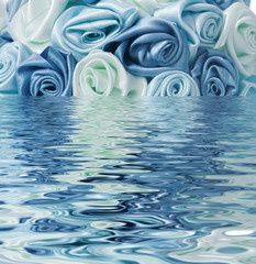 Blue rose reflected in the water