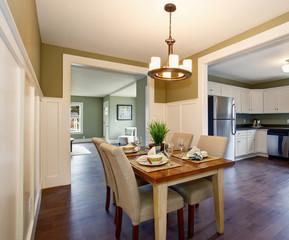 Modern dinning room with hardwood floor and hanging light fixtur
