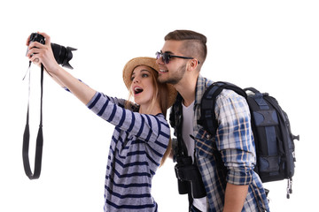 Pair of travelers with camera isolated on white