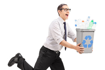 Joyful man running with a recycle bin in his hands