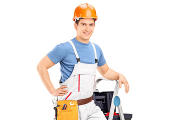 Male electrician standing on a ladder
