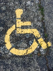 Handicapped parking symbol painted on asphalt