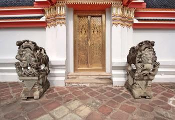Buddhist temple lion statue. Wat Pho. Bangkok.