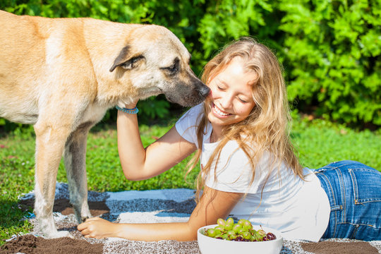 Beautiful teenager girl outdoor with a dog