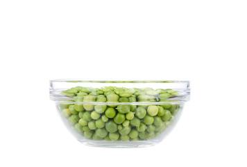 Fresh garden peas in a glass bowl.
