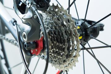 Cassette, derailleur and rear wheel of a modern, carbon racing bike. Shallow DOF.