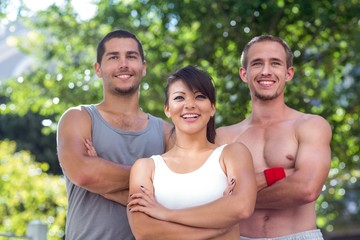Smiling extreme athletes standing with arms crossed