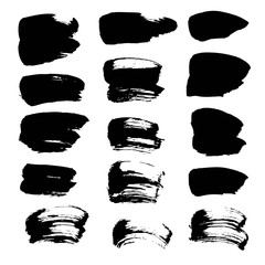 Abstract spots of black paint and ink isolated on a white backgr