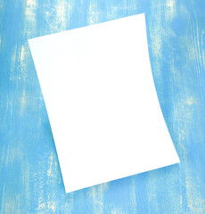 Blank flyer poster on wooden background to replace your design.
