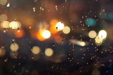 Water drops on a window glass after the rain and  abstract circular bokeh background