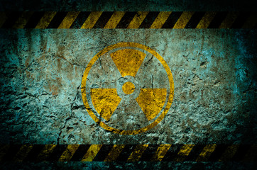 Nuclear radiation warning symbol on grunge wall background