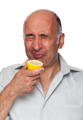 Man puckers after tasting a lemon