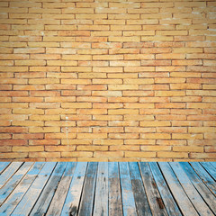 old wooden floor on brick wall grung background