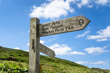 Coast Path Direction Sign in Cornwall and Blue Sky