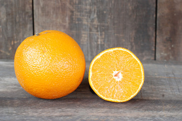 Orange on a wooden floor