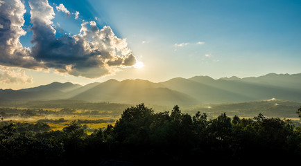 Landscape view with sunset and mountain range in Pai district, Northern Thailand