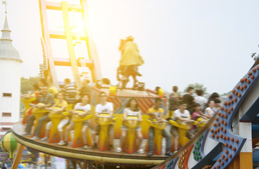 soaring across the skies in amusement park