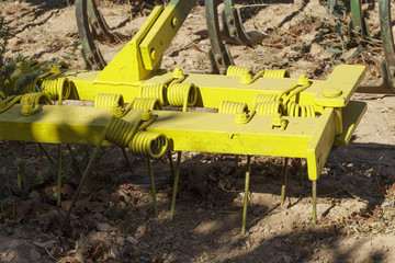 Detail view of grilles of a plow mounted behind the ploughshares