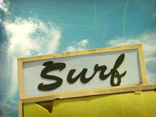 aged and worn vintage photo of surf sign
