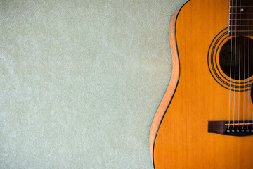 half of an acoustic guitar on a blank background