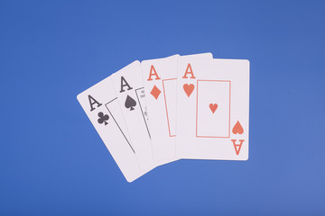 Four aces isolated on blue background
