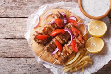 Greek food: Souvlaki with vegetables and pita bread. horizontal top view