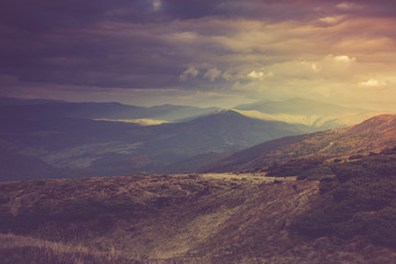 Poster Hill Autumn mountain hills at sunset.