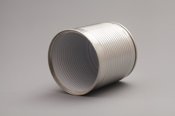 A silver tin can isolated on a gray background