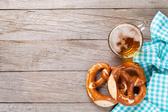 Beer mug and pretzel on wooden table