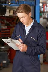 Apprentice Mechanic Working In Auto Repair Shop