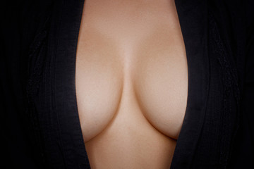 Topless woman body covering her big breast