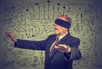 Portrait blindfolded elderly senior business man going through social media data