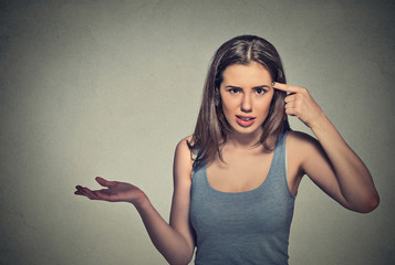 angry mad young woman gesturing asking are you crazy?