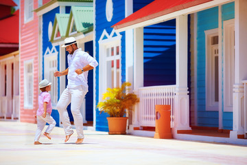 happy father and son enjoy life, dancing on caribbean street