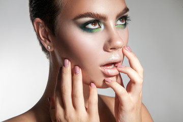 portrait of beautiful girl with make-up with hands and healthy s