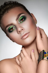young beautiful girl with beautiful makeup in green colors  and