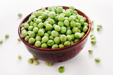 bowl of green peas on a white background