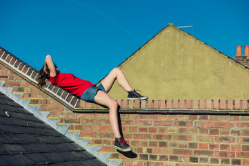 Young woman lying on a roof