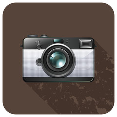 Retro vintage camera on tile
