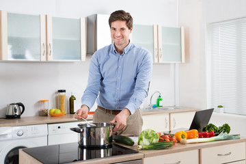 Man Cooking Food In Kitchen