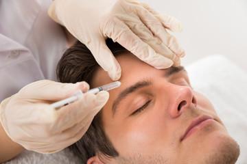 Man Having Cosmetic Treatment