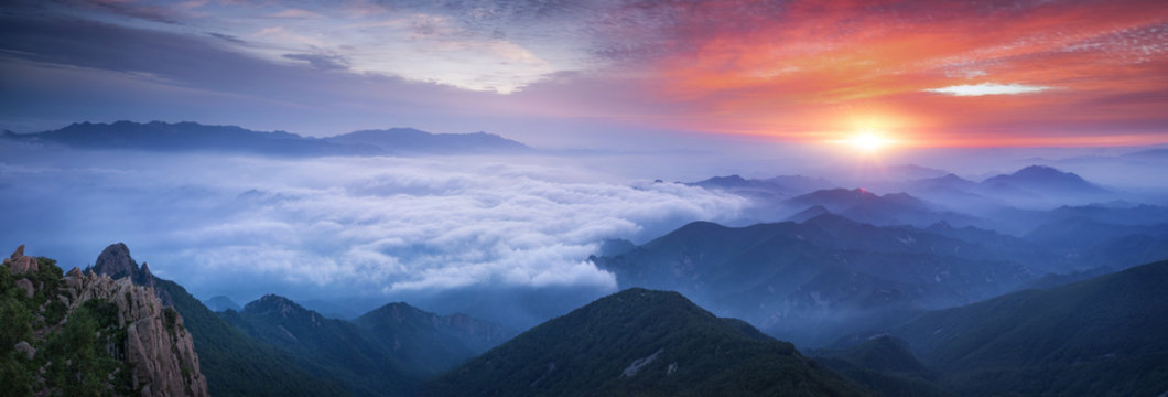 Fog and cloud mountain at sunrise