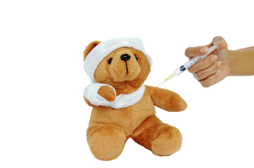 Bear doll are being injected.