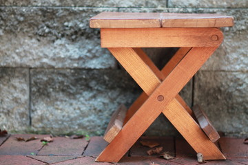 Wooden stool with X legs