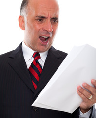 Mad business man holding pages